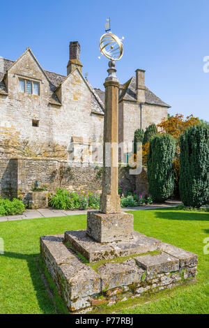 The sundial in Armillary Court at Snowshill Manor in the Cotswold village of Snowshill, Gloucestershire UK - Stock Photo