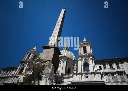 Piazza Navona Square, Bernini's 4 Rivers Fountain and Egyptian obelisk in front of Borromini's Saint Agnese in Agone church. Rome, Italy, Europe. - Stock Photo