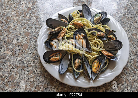 spaghetti pasta with mussels garlic and parsley 5 - Stock Photo