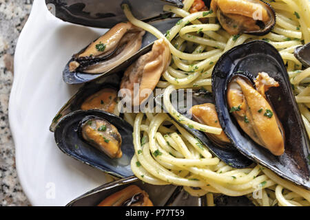 spaghetti pasta with mussels garlic and parsley 6 - Stock Photo