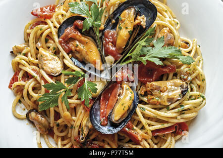 spaghetti pasta with mussels tomato and parsley - Stock Photo