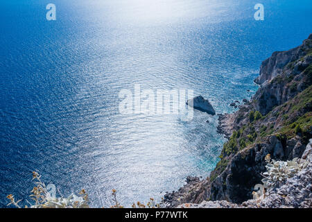 Aerial view on Turquoise Lagoon. Tropical Beach. Scenic Seascape. Rocky coast line. Summer vacation concept. Copy space. Deep blue water - Stock Photo