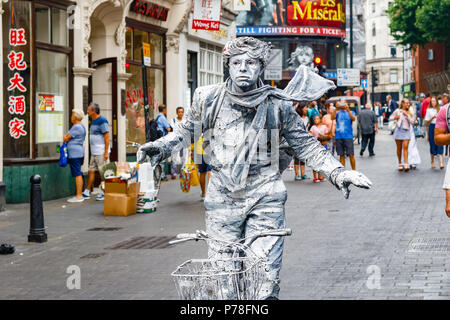 London, UK - June 22, 2018 - Street artist performing living statue in London Chinatown - Stock Photo