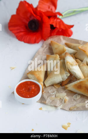 Phyllo pastry pies stuffed with spinach and feta, close view - Stock Photo