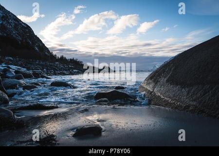 Ocean sunset on a stony Lofoten beach - Norway - Stock Photo