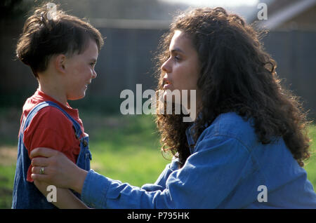 Anglo-Israeli mother talking to her young son outside - Stock Photo