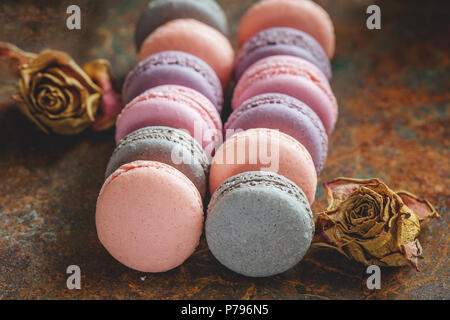 Freshly baked multi-colored macaroons close-up, selective focus. - Stock Photo