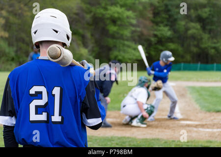 High School Baseball Player waiting for his at bat - Stock Photo