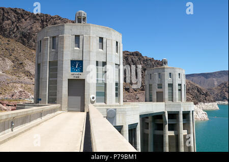 Architectural View of Clock Tower Structure on top of Hoover Dam, a Popular Tourist Attraction on Border of Arizona and Nevada, USA, on Sunny Day - Stock Photo