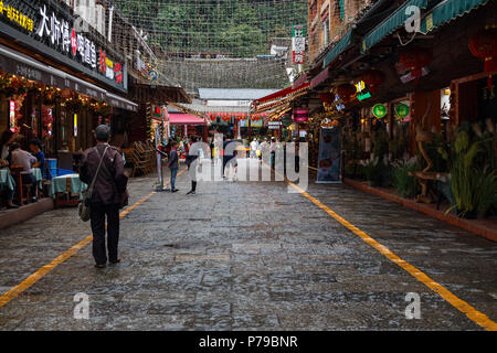 YANGSHUO, CHINA - MAY 10, 2018: Shopping street with restaurants and eateries near the market in the downtown of Guilin city, Guangxi, China. Peace fa