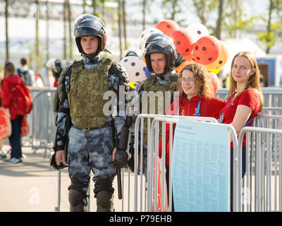 SAINT PETERSBURG. RUSSIA - JULY 03 2018. Heavy equipped police guards and volunteers at entrance in FIFA world cup match Sweden - Switzerland on Krest - Stock Photo