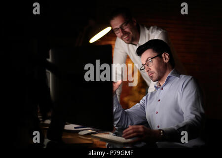 businessman working with documents dark office - Stock Photo