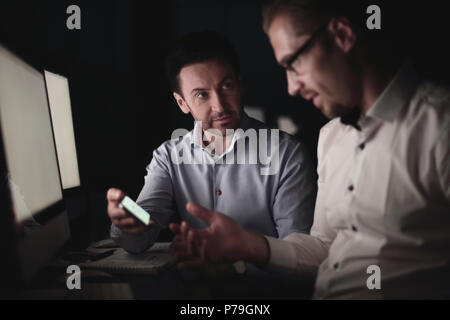 close up.two business men looking at the smartphone screen. - Stock Photo