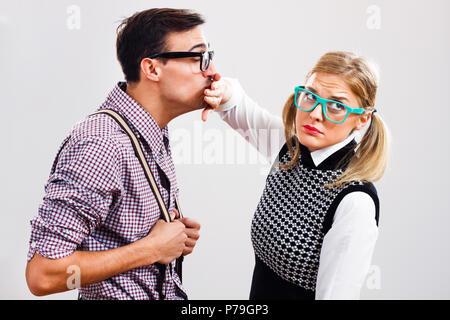 Nerdy woman doesn't like this nerdy man. - Stock Photo