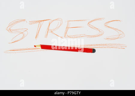 Stress note written with red crayon. - Stock Photo