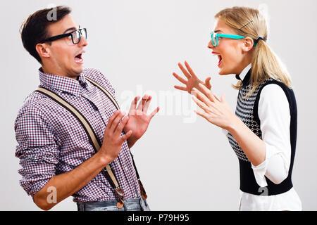 Nerdy couple having conflict - Stock Photo