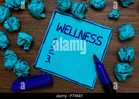 Handwriting text Wellness. Concept meaning Making healthy choices complete mental physical relaxation Cyan paper imagination idea thoughts mistakes se - Stock Photo