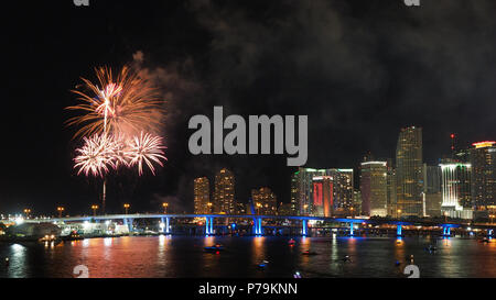 Fire works celebrating American Independence Day (Fourth of July) and the City of Miami skyline, Miami, Florida, 2018. - Stock Photo