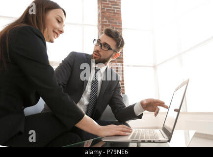 Couple of young designers working at modern office - Stock Photo