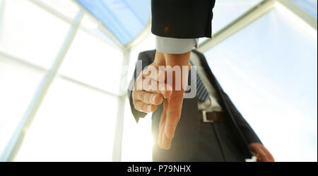 Two  business men going to make handshake - Stock Photo