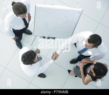 view from the top. background image of handshake of business partners - Stock Photo