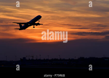 Silhouette, airplane taking off at sunset, Munich Airport, Upper Bavaria, Bavaria, Germany - Stock Photo