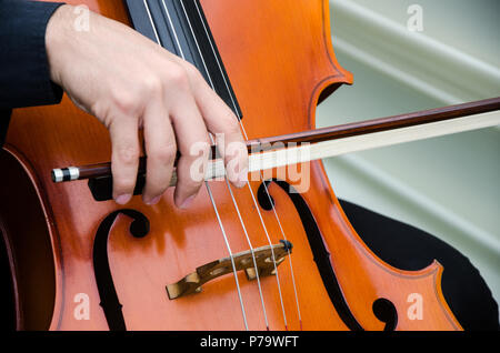 Art and artist. Young elegant man violinist playing violin on black. Classical music. little boy musical instrument.