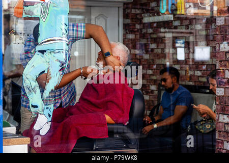 A Man Having A Wet Shave In A Hairdressing Salon, Brick Lane, London, United Kingdom - Stock Photo