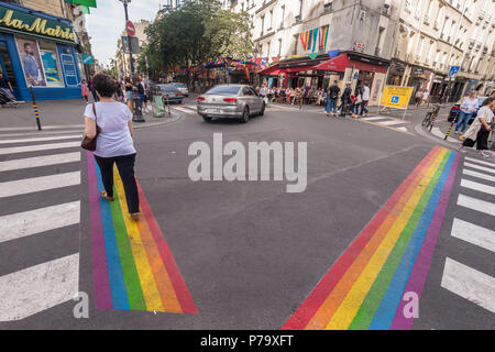 Paris, France - 24 June 2018: Gay pride flag crosswalks in Paris gay village (Le Marais) - Stock Photo