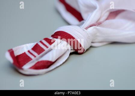 Knot in handkerchief - Stock Photo