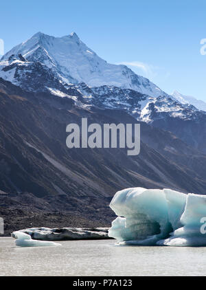 Iceberg floating on the terminal lake of Tasman Glacier in the south island of New Zealand. The retreating glacier has left a lake which fills with ic - Stock Photo
