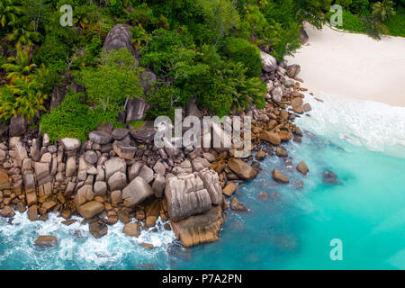Aerial view of a secluded beach on Praslin, Seychelles in the Indian Ocean. - Stock Photo