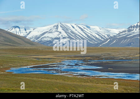 Artic Tundra scene on Spitsbergen, Svalbard, Norway in the Arctic Circle - Stock Photo