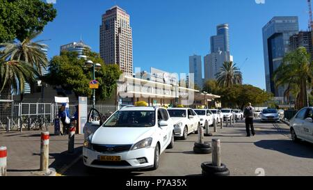 Taxis lined up in front of the Tel Aviv Savidor Central Railway Station, one of the main transportation hubs of Israel. - Stock Photo