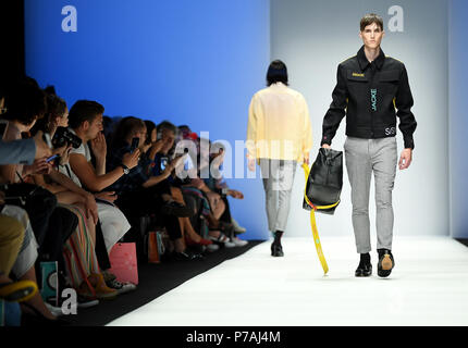 Berlin, Germany. 05th July, 2018. Models wearing creations of the label Ivanman. The collections for spring/summer 2019 are being presented at Berlin Fashion Week. Credit: Britta Pedersen/dpa-Zentralbild/dpa/Alamy Live News - Stock Photo