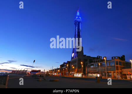 Blackpool,UK.5th July 2018. Blackpool tower shines in blue light on the night of the 5th July to commemorate the 70th anniversary of the NHS. One of the iconic tourist attractions in the country the blue glow was seen from miles around the Fylde coast and Lancashire. Kev Walsh/Alamy Live News - Stock Photo