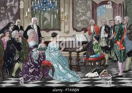 Mozart family grand Tour. Maria Anna (Nannerl) and Wolfgang Amadeus playing  before the Empress Maria Theresa (1717-1780) at the Imperial Court. Vienna, 1762. Engraving by R. Brend'Amour. Colored. - Stock Photo