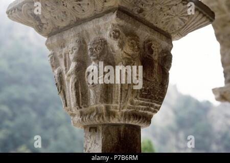 Monastery of Saint Martin du Canigou. Detail of a capital depicting Father Abbot celebrating mass surrounded by monks. 12th-13th centuries. France. - Stock Photo