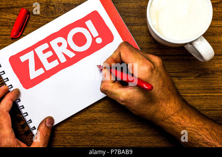 Text sign showing Zero Motivational Call. Conceptual photo The emptiness nothingness of something no value Cup marker red pen notepad white paper nice - Stock Photo