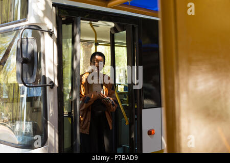 Woman getting out from the bus - Stock Photo