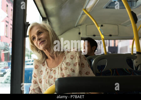 Senior woman travelling in the bus - Stock Photo