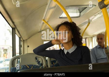 Woman travelling in the bus - Stock Photo