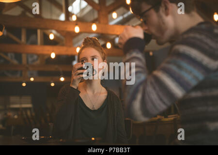 Couple having coffee at the counter - Stock Photo
