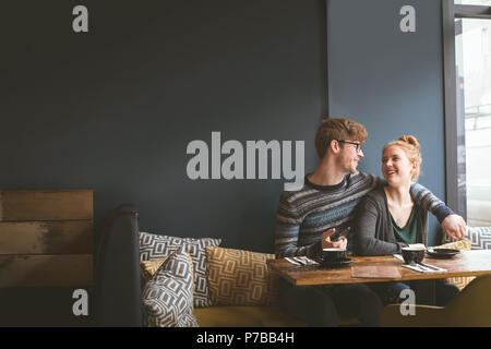 Couple talking to each other in cafe