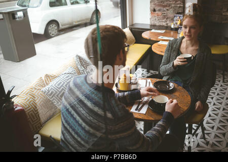 Couple talking over the coffee at cafe - Stock Photo