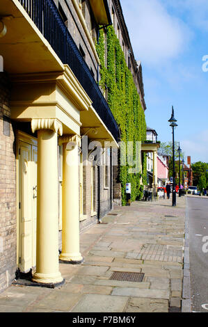 Bury St Edmunds, UK - May 15 2018:  A view of Angel Hill in Bury St Edmunds on a sunny day with the Angel hotel - Stock Photo