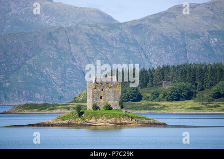 Castle Stalker (Caisteal an Stalcaire) is a four-storey tower house or keep picturesquely set on a tidal islet on Loch Laich, an inlet off Loch Linnhe - Stock Photo