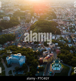 Aerial Panoramic view to the Andreevsky Descent at sunset with the St. Andrew's Church and emerald hills - Stock Photo