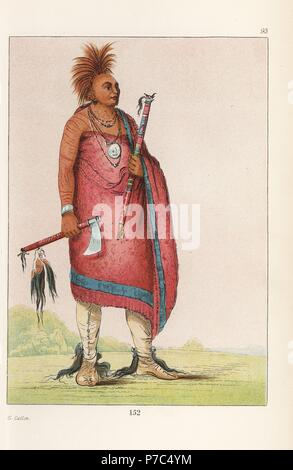 Chief Tehong-tas-sab-bee, Black Dog, of the Osage nation with tobacco pipe, tomahawk with scalp-locks, shaved head with dyed-red deer hair crest, moccasins with scalps, and mackinaw blanket. Handcoloured lithograph from George Catlin's Manners, Customs and Condition of the North American Indians, London, 1841. - Stock Photo