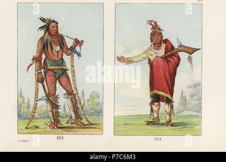 Winnebago men: chief Naw-kaw, Wood 254 and Wah-chee-hahs-ka, Man Who Puts All Out of Doors 255, with rattlesnake skins on his arms holding a war club and tobacco pipe. Handcoloured lithograph from George Catlin's Manners, Customs and Condition of the North American Indians, London, 1841. - Stock Photo